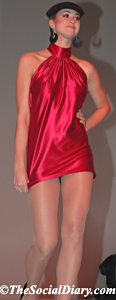model in short red satin dress